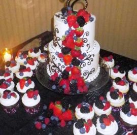 R & C - Fresh fruit topped cupcakes and fruit cascae on rounds.jpg